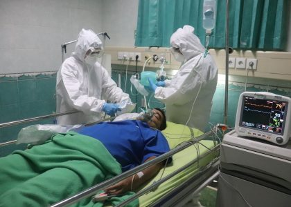 man in white medical scrub lying on hospital bed